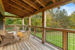 Large covered deck off living room is the perfect place to relax on a Summer or fall day