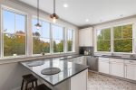 Natural Light streams through the gleaming kitchen windows