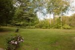 Expansive backyard perfect for relaxing or playing lawn games