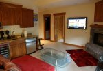 Den open to private hot tub, bunk bed room next to TV and bathroom
