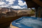 Outdoor private hot tub facing the mountains