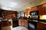 Beautiful kitchen with large granite counters and modern appliances