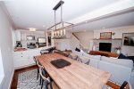 Granite counters, cherry cabinets and stainless appliances in kitchen