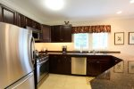 Granite and cherry kitchen with everything you require