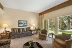 Well-appointed living room with plenty of seating and access to the backyard