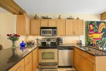 The well-equipped kitchen provides all the comforts of cooking in your own home