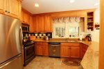 Large open kitchen perfect for preparing meals