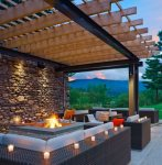 Outdoor seating by the fire during sunset