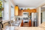 Stainless steel appliances and granite counter tops in the kitchen