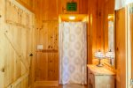 Main level bathroom with stall shower