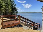 Looking out towards the water and the firepit/adirondack chair area
