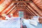 Rustic double twin bedroom in loft above the barn. Please note: this is exposed from underneath and not heated
