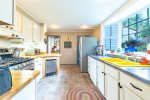 Colorful and well equipped kitchen with updated appliances