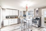 Well-equipped kitchen with stainless steel appliances