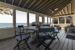 Screened in porch with panoramic views of the ocean