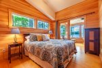 Queen bedroom facing the water which leads out to the sunporch