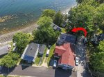 Red arrow points to cottage - Aerial views