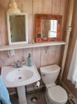 Off the kitchen is a guest bathroom with shower and laundry