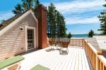 Walk Out the Master Bedroom to Private Deck with Outdoor Furniture and Water Views