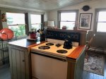 The tidy kitchen is well appointed and fully equipped