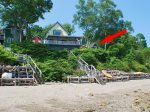 Although the cottage is not direct waterfront, the beach is a 2 minute walk via a neighborhood right-of-way.  Harmony indicated by the red arrow