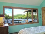Queen bedroom and views from bed of the lake and Bald Mountain