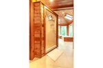 Large screened-in porch with table tennis