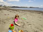 A younger Guest enjoying the sand out in front of the Cottage