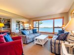 Large living/seating area with ocean views