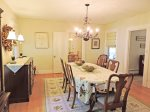 Continuing through the house from the kitchen is the formal dining room