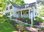 A traditional New England frame house with covered porch and nice yard space