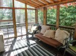The screen porch is a great spot to sit and relax