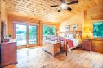 Master king bedroom on the main level with private access to the deck facing the lake