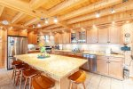 Expansive and well equipped kitchen with stainless steel appliances