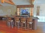 Bar area with large flat screen TV and ice maker