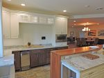 Kitchen with numerous appliances, high-end cookware and ice maker
