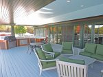 Covered deck with numerous seating areas for gathering