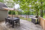 Enjoy the BBQ and sitting area on deck overlooking the pond