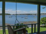 Porch views of one of the prettiest working harbors in Maine. Sit on the porch swing and relax the day away