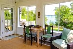 Sunroom with water views and access to the deck