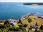 The property sits at the entrance to a scenic cove overlooking a beautiful coastal island