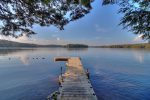 Dock Sitting Lakeside with a Roped off Sandy Beachfront Area and Gorgeous Lake and Mountain Views
