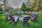 Fire pit Encircled with Adirondack Chairs Facing The Lake and Mountains
