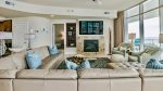 Luxurious wet bar with ice maker, sink, and wine cooler