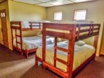 The lower level bunk room has two twin over full bunk beds- great for large groups of friends or a family reunion.
