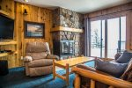 Living area includes gas fireplace, flat screen t.v. and Lake Superior view.