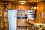 The kitchen is equipped with all appliances needed and seating for 3.