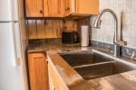 The remodeled kitchen features new countertops and a drop in sink.