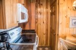 The kitchen has full sized appliances and is well equipped to prepare home cooked meals.