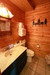 Beautifully remodeled bathroom features tub and shower combo